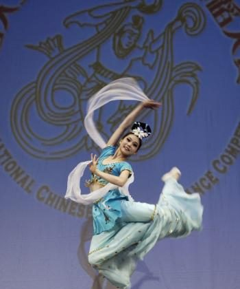 Contestant #13 Jialin Chen of the Junior Female division leaps during a solo performance in the 2nd NTDTV Chinese Classical Dance Competition preliminaries on August 22 at the Town Hall Foundation in New York City. (Bing Dai/The Epoch Times)