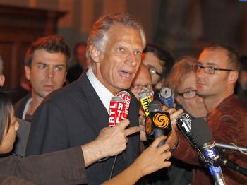 Former French Prime Minister Dominique de Villepin (C) adresses journalists at a Paris courthouse, at the end of the so-called 'Clearstream affair' trial last Friday. (Patrick Kovarik/AFP/Getty Images )