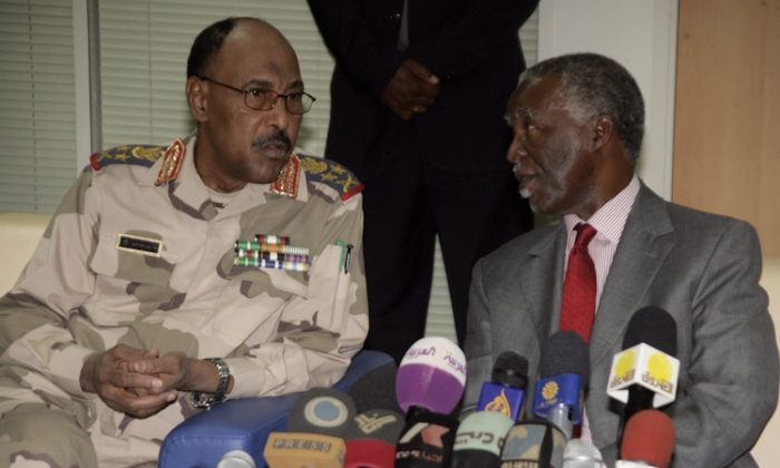 Sudanese Defense Minister Abdel Rahim Mohamed Hussein (L) and chief African Union mediator and former South African president Thabo Mbeki (R) speak prior to their press conference about the release of the UN deminers on May 20, 2012. (Ashraf Shazly/AFP/GettyImages)