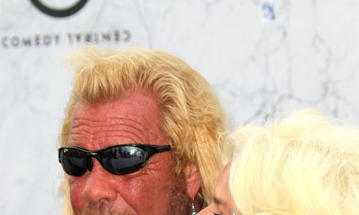 TV personality Dog the Bounty Hunter (L) and his wife Beth Chapman arrive at Comedy Central's Roast of Charlie Sheen held at Sony Studios on September 10, 2011 in Los Angeles, California. (Frederick M. Brown/Getty Images)