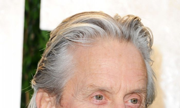 Actor Michael Douglas arrives at the 2012 Vanity Fair Oscar Party hosted by Graydon Carter at Sunset Tower on Feb. 26 in West Hollywood, Calif. The Federal Bureau of Investigation has enlisted Douglas to film a new public service announcement ad denouncing financial crimes. (Pascal Le Segretain/Getty Images)