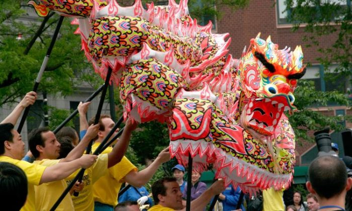 In this file photo, dragon dancers greet crowds at Union Square Park in New York City. (Tim McDevitt/The Epoch Times)