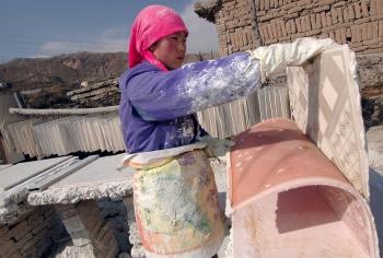 A villager works at her plasterboard workshop in 2005 in Qinghai Province, China. The U.S. has banned all imports of drywall from China after a study concluded that there is a link between the drywall and corrosion of metal and appliances in homes throughout the U.S. (China Photos/Getty Images)