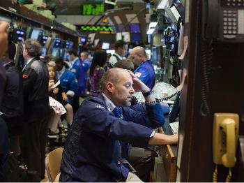 Traders work the floor at the New York Stock Exchange on November 27, 2009 in New York City. U.S. markets dropped on Friday, reacting to global worries over Dubai's debt problems. (Michael Nagle/Getty Images)