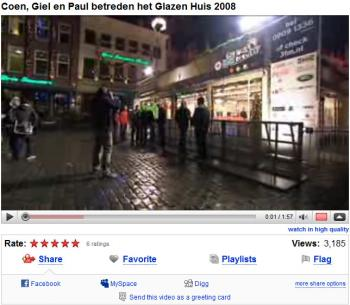 Screenshot of a video which shows the glass house in the middle of Breda where the DJs stayed to raise money.  (Youtube image)