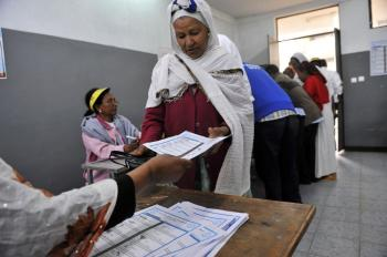 An Ethiopian woman gets ballot papers at a polling station on May 23, in the capital Addis Ababa. Ethiopians began voting in legislative elections on May 23. Prime Minister Meles Zenawi appeared set for re-election although the main opposition party Medrek, has made allegations of election fraud in some areas. (Simon Maina/AFP/Getty Images)