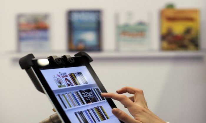 Opting for e-books. (Robert Michael/Getty Images)