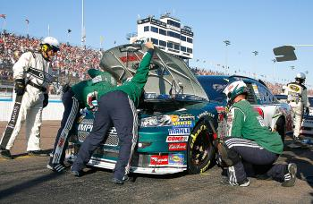 Crew members work to repair damage suffered by Dale Earnhardt Jr., driver of the #88 AMP Energy/National Guard Chevrolet during lap 169 pile-up. (Jason Smith/Getty Images for NASCAR)