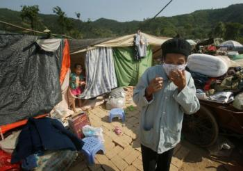 Photo shows survivors of the May 12 earthquake in temporary shelters in Qingchuan County of Sichuan Province, China. Qingchuan County was hit Tuesday by a 6.1-magnitude quake. (Getty Images)