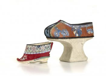 Platform silk slippers also covered in embroidery.