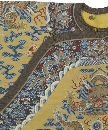 Items of Qing court dress are covered from top to toe in the most detailed and refined silk embroidery.