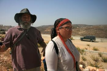 Baruch and Sandra Orman hike up a mountainside outside of their town of Efrat in the West Bank.  (Genevieve Long/The Epoch Times)