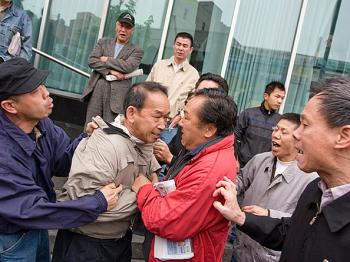 Flushing resident Edmond Erh was assaulted by a pro-CCP mob while supporting a booth for quitting the Chinese Communist Party.  (Dayin Chen/The Epoch Times)