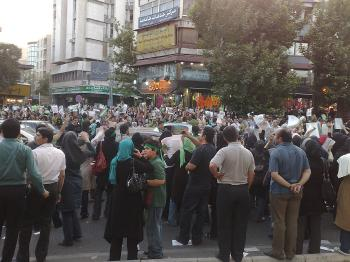 Supporters of Mousavi covered in his green campaign color gather in the streets in the days leading up to the election. (Mazdak Kermani/The Epoch Times)