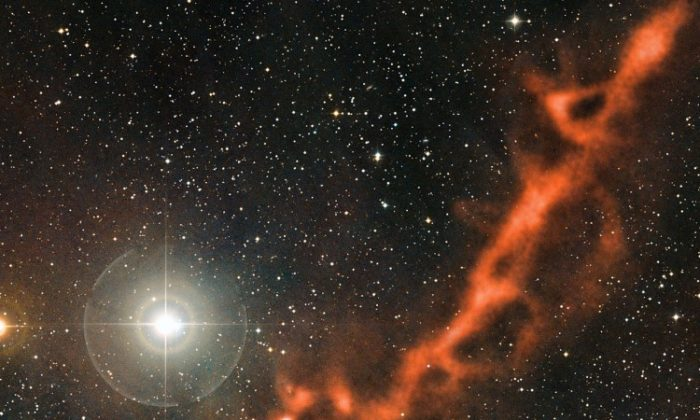 The Taurus Molecular Cloud in the constellation of Taurus, about 450 light-years from earth. (ESO/APEX (MPIfR/ESO/OSO)/A. Hacar et al./Digitized Sky Survey 2. Acknowledgment: Davide De Martin.)
