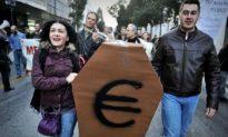 EU/IMF Aid Nears as Greek Debt Downgraded