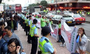 A Group in Hong Kong Appears as Front for Beijing