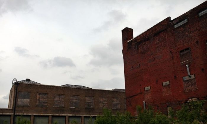 Closed factories seen earlier this month in Utica, N.Y. Over the years, most of America's manufacturing capabilities have been outsourced to third-world countries in an effort to eliminate labor costs and boost earnings, according to a number of economists. (Spencer Platt/Getty Images)