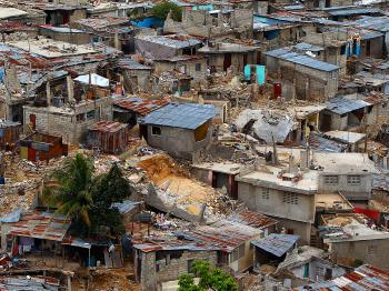 Standing and collapsed homes cover the hillside in the Le Vallee de Bourdon neighborhood in Port-au-Prince, Haiti, February 18, 2010 More than a month after the 7.0 earthquake that destroyed much of Port-au-Prince hundreds of thousands of people are livin (Chip Somodevilla/Getty Images)