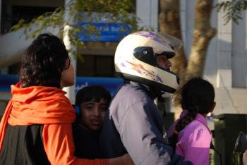 FAMILY OUTING: A family of four riding a motorcycle to run errands around Islamabad, Pakistan. Families of four or more on motorcycles are a very common sight. (Masooma Haq/ The Epoch Times)