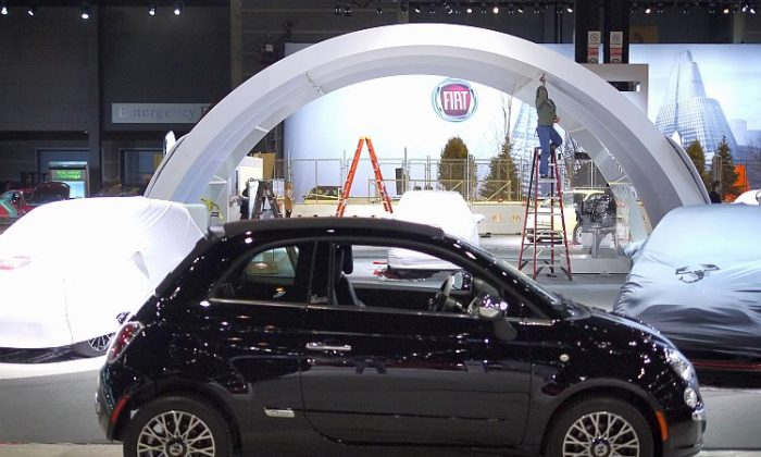 A Fiat 500 subcompact is prepared for display at the Chicago Auto Show on Feb. 7. The Fiat 500 had huge sales gains in March, benefitting from high gas prices and clever marketing. (Scott Olson/Getty Images)