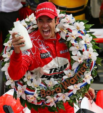 Helio Castroneves celebrates in victory lane after winning the Indianapolis 500. (Darrell Ingham/Getty Images)