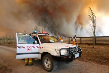 Country Fire Authority staff monitor a giant fire raging in the Bunyip State Park near Labertouche on February 7, 2009. (William West/AFP/Getty Images)