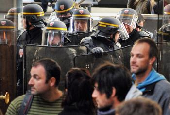 Anti-riot policemen contain some 800 on strike rail workers gathered at Bordeaux's Saint-Jean station on Oct. 22, 2010 to protest against the government's bid to hike the retirement age from 60 to 62. (Pierre Andrieu/AFP/Getty Images)