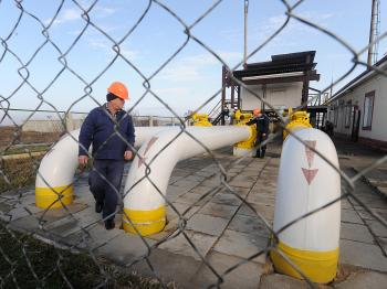 A worker at the Orlovka gas-compressor station near the Ukraine-Romanian border, monitors the equipment on a gas pipe-line.   (Sergei Supinsky/AFP/Getty Images)