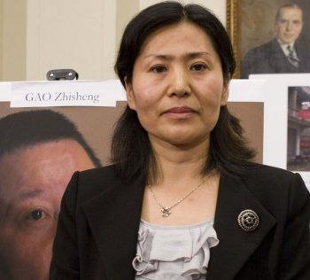 HUSBANDLESS: Geng He, wife of civil rights attorney Gao Zhisheng. Gao has released several letters detailing the torture he was subjected to while in captivity. He is currently being held in extralegal custody, and his whereabouts and welfare are unknown. (Lisa Fan/The Epoch Times)
