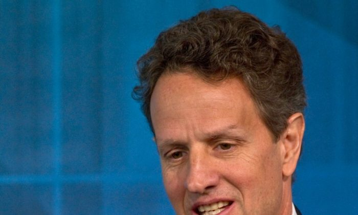 U.S. Treasury Secretary Tim Geithner addresses a conference ahead of the spring meetings of the International Monetary Fund in Washington in this file photo from April 2011. (Nicholas Kamm/Getty Images)