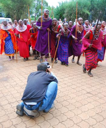PROUD PEOPLE: A tourist snaps a picture of members of the Maasai tribe who give performances at a local hotel. (Wes LaFortune)