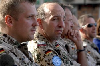 German soldiers from the International Security Assistance Force (ISAF) listen to speeches during a ceremony on June 17, 2007, to pass a police training program to the European Mission in Kabul, Afghanistan. (Shah Marai/AFP/Getty Images)