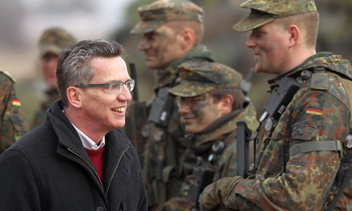 German Defense Minister Thomas de Maizière greets troops of the 37th Armored Infantry Brigade at the Bundeswehr combat training center on March 9, 2011, in Letzlingen, Germany. (Sean Gallup/Getty Images)