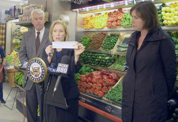 RECALL SAFETY: Sen. Kirsten Gillibrand (C) displays an example of a coupon stores would use to notify shoppers of food recalls. (L) Dr. Philip J. Landrigan-professor of Pediatrics and chairman of the Department of Community & Preventive Medicine at Mount Sinai School of Medicine (R), and Pam Berger from Safe Tables Our Priority organization (STOP). (Photo courtesy office of Sen. Gillibrand)