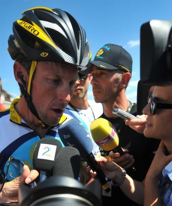 Lance Armstrong talks to the press before the start of Stage Twelve of the Tour de France. (Lionel Bonaventure/AFP/Getty Images)