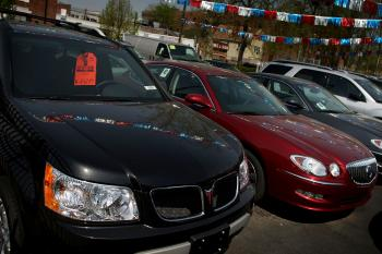 Pontiac cars are displayed at a a General Motors dealership on April 27, 2009 in the Queens borough of New York City. GM has announced that it will be to cutting 21,000 Jobs and will eliminate the Pontiac brand. (Spencer Platt/Getty Images)