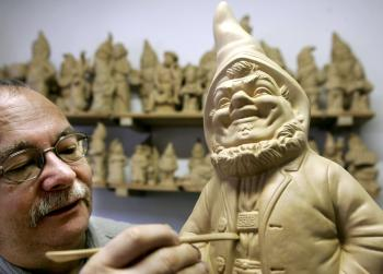 An artist carves a gnome ornament in his German workshop. Though the gnome has become a garden cliché, it originates in tales of little people which are popular throughout the world. (Ens-Ulrich Koch/AFP/Getty Images)