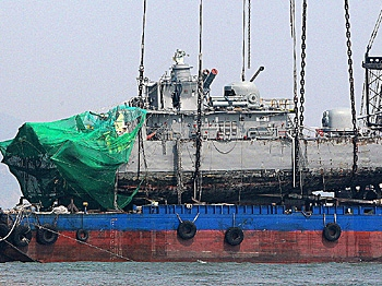 Sunken South Korean warship PCC-772 Cheonan is placed on a barge after being raised by a giant crane, April 15, 2010. South Korea's military believes a North Korean submarine torpedoed a South Korean warship in March, the Yonhap news agency said. (Byun Yeong-Wook/AFP/Getty Images)