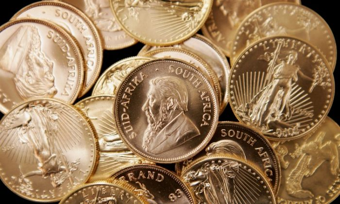 American Eagle and South African Krugerrand gold bullion is offered for sale at the Chicago Coin Company in Chicago, Ill., in this file photo. Gold prices are predicted by some to be stable this year and rise next year. (Scott Olson/Getty Images)