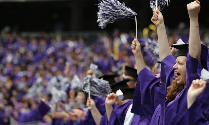 Graduating students celebrate at New York University's commencement ceremony at Yankee Stadium on May 16, 2012 in the Bronx borough of New York City. (Mario Tama/Getty Images)