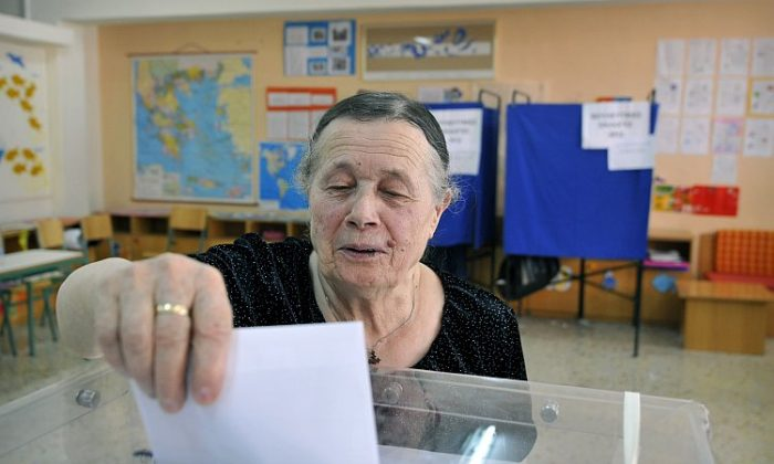A woman casts her vote for Greece's general elections in a polling station in Athens on May 6, 2012. (Louisa Gouliamaki/AFP/GettyImages)