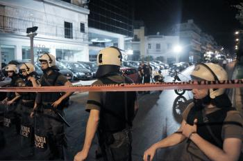 Police secure area after an explosion outside a prison wounded one person on May 13. Another bomb exploded inside a courthouse in the northern Greek city of Thessaloniki on Friday. (Milos Bicanski/Getty Images)