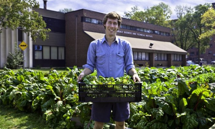Ian Hepburn-Aley of FoodShare holds produce grown at Toronto's Bendale School Market Garden. Urban farming is gaining momentum in Canada as more people look towards ways urban centres can produce more food on rooftops or backyards now covered with grass. Toronto will host the first-ever Urban Agriculture Summit from Aug. 15 to 18. (Courtesy of Laura Berman, GreenFuse Photography)
