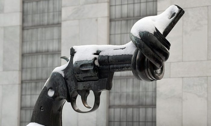 Snow covers a sculpture of a gun with a twisted barrel on the grounds of the United Nations last year in New York. (Don Emmert/AFP/Getty Images)