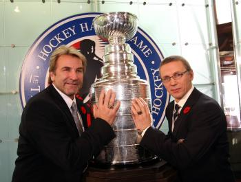 INDUCTED: Igor Larionov (right) and Edmonton Oiler great Glenn Anderson pose for photos at the Hockey Hall of Fame in Toronto.  (Bruce Bennett/Getty Images)