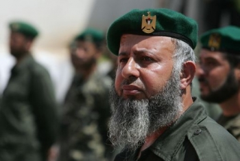 A Hamas security man looks on as his leader Ismail Haniya (unseen) reviews the honour guard during a visit to the Hamas security headquarters in Gaza City on July 7, 2008. (Mohammed Abed/AFP/Getty Images)