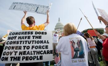 Health care reform: Supporters of the Tea Party movement demonstrate outside the US Capitol in Washington in March 2010 against the health care bill. A Florida judge ruled the health care law unconstitutional on Monday. (NICHOLAS KAMM/AFP/Getty Images)