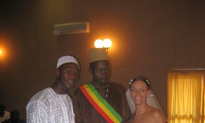Lainie Towell and Fodé Mohamed Soumah (L) on their wedding day in Guinea, West Africa, in 2007. Towell's efforts to bring attention to her own case of marriage fraud may have contributed to tighter laws currently being introduced by the Canadian government to deter marriages of convenience. (Photo courtesy of Lainie Towell)
