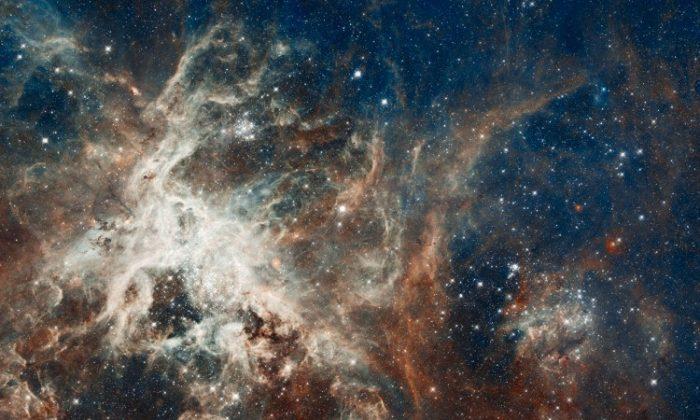 30 Doradus is the brightest star-forming region in our galactic neighbourhood and home to the most massive stars ever seen. (NASA, ESA, ESO, D. Lennon and E. Sabbi (ESA/STScI), J. Anderson, S. E. de Mink, R. van der Marel, T. Sohn, and N. Walborn (STScI), N. Bastian (Excellence Cluster, Munich), L. Bedin (INAF, Padua), E. Bressert (ESO), P. Crowther (Sheffield), A. de Koter (Amsterdam), C. Evans (UKATC/STFC, Edinburgh), A. Herrero (IAC, Tenerife), N. Langer (AifA, Bonn), I. Platais (JHU) and H. Sana (Amsterdam))